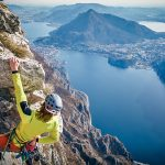 Member of Ragni group Maurizio Tasca climbs Forcellino wall close to Lecco and its wonderful lake (ph. Ragni di Lecco)