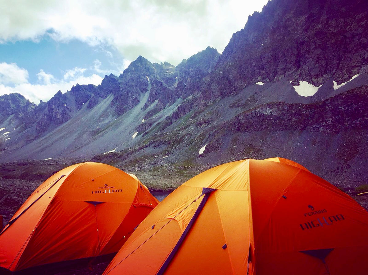 The Ferrino HighLab Base Camp located in a breath-taking setting, in a basin under the east side of the Monviso.