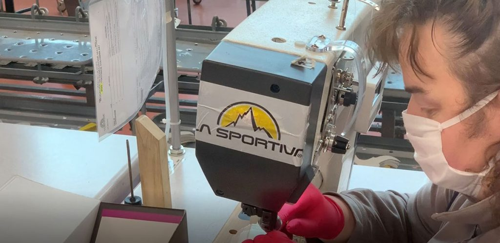La Sportiva Italy has converted part of its production line to make laboratory coats and masks for the Protezione Civile (Civil defence) of Trento.