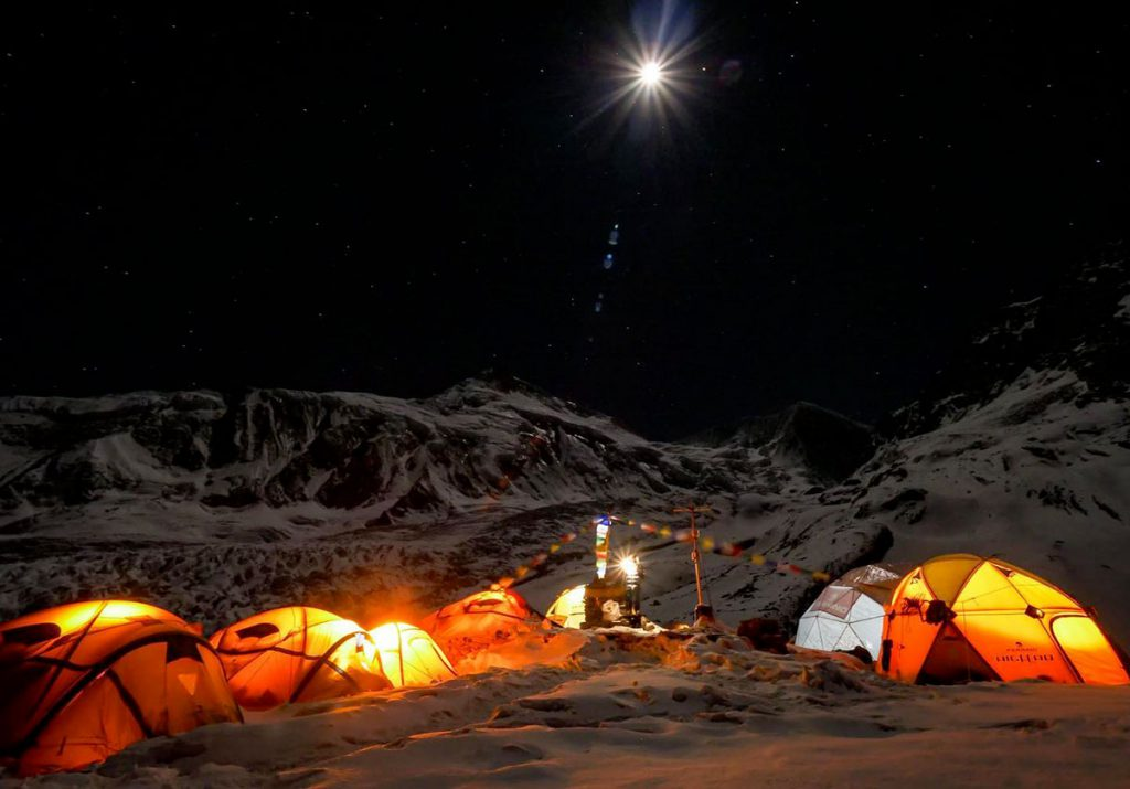 Alex Txikon & team including Simone Moro, Iñaki Álvarez and Cheppal Sherpa begin the second high rotation as they try to make a winter ascent of Manaslu. © Phelipe Eizaguirre